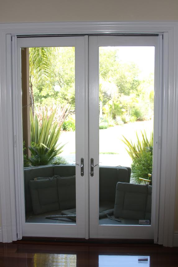 Retractable screen door wesco screen company work gallery for Andersen french door retractable screens